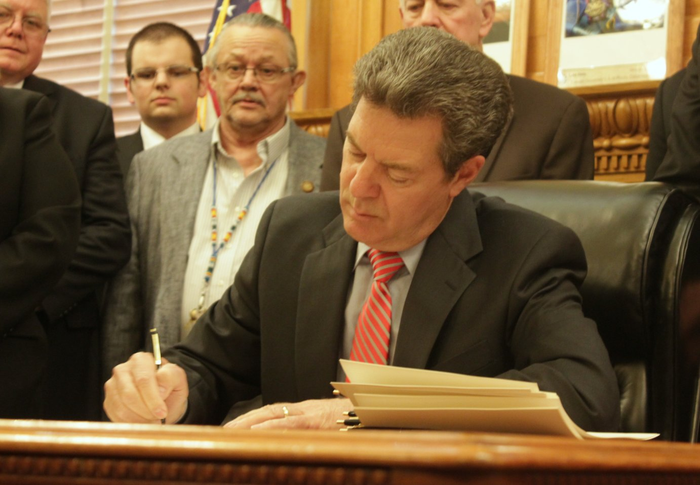 Governor Brownback signing a bill earlier this month. (Photo by Stephen Koranda)