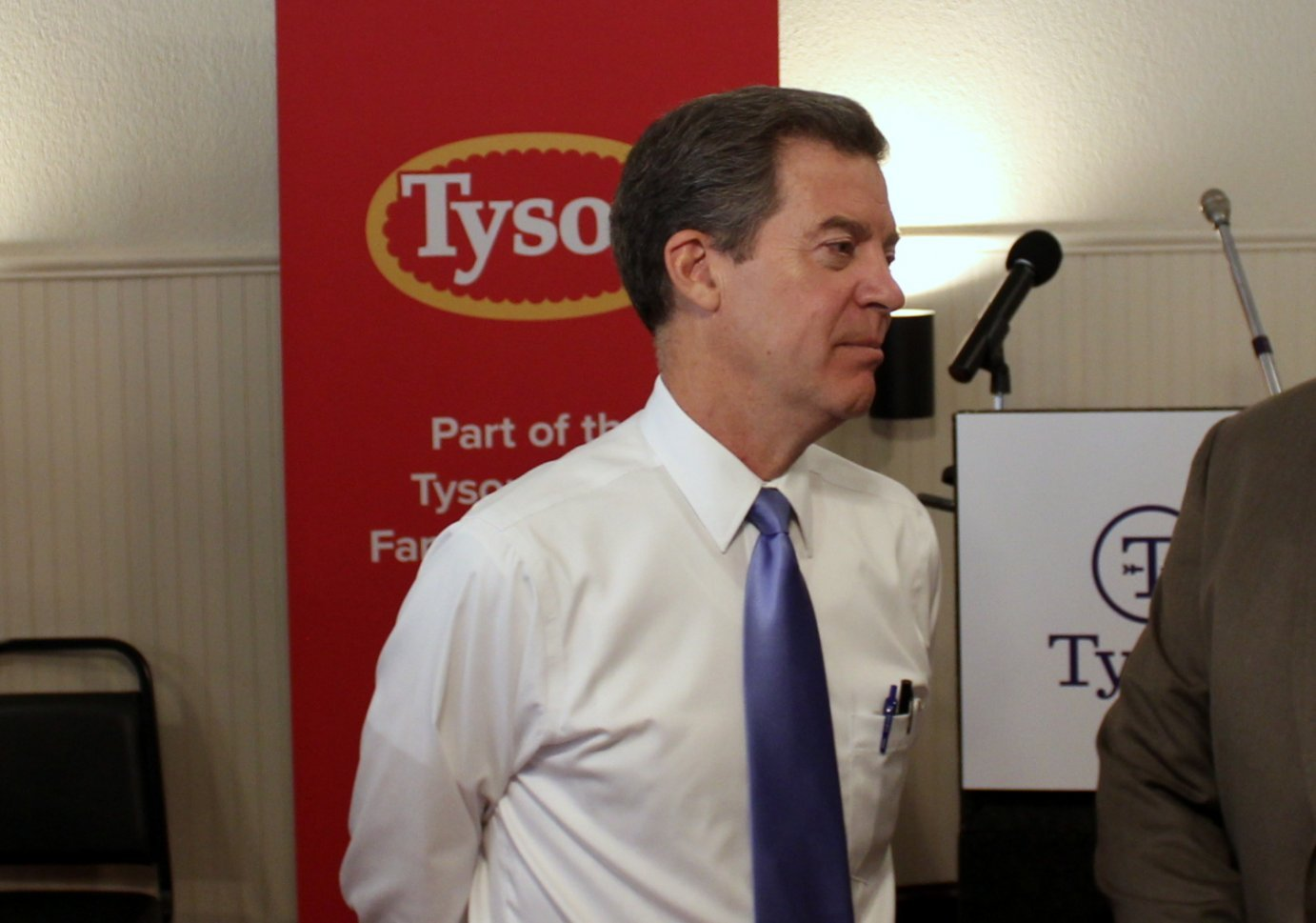 Governor Sam Brownback at the announcement of the original Tyson plant proposal. Members of Brownback's cabinet are now trying to find a new home for the plant in Kansas. (Photo by Stephen Koranda)