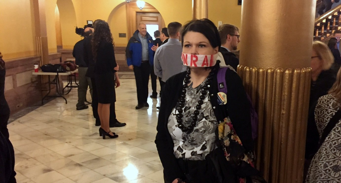An opponent of the state's campus carry law outside the hearing Wednesday. (Photo by Stephen Koranda)