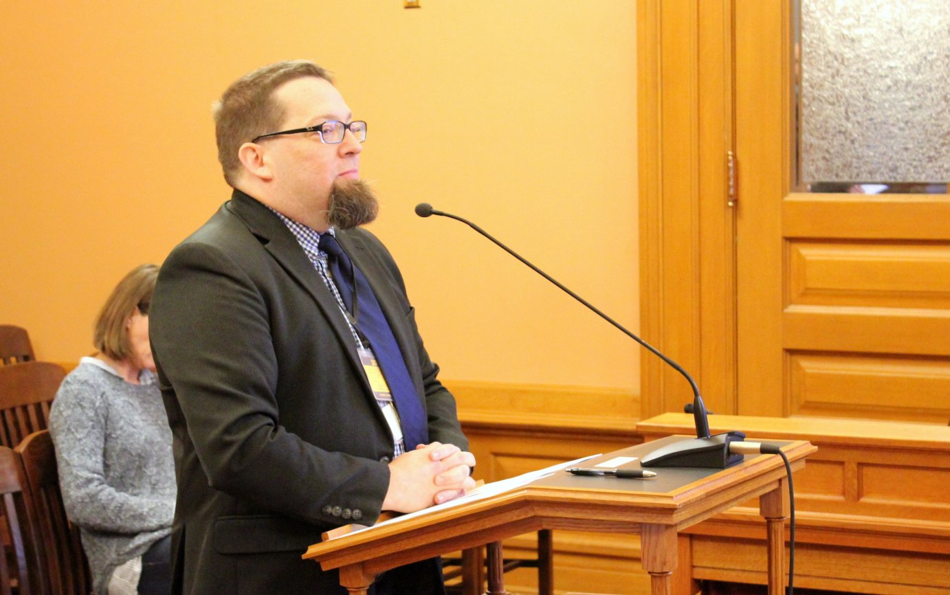 Kansas Director of Elections Bryan Caskey listens to a question during the committee meeting Monday. (Photo by Stephen Koranda)