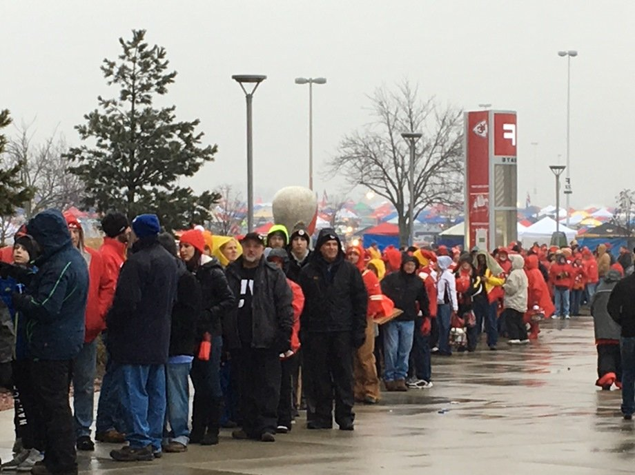 Chiefs fans waited in a cold rain to get into Arrowhead Stadium for Sunday's play-off game. (Photo: Greg Echlin)