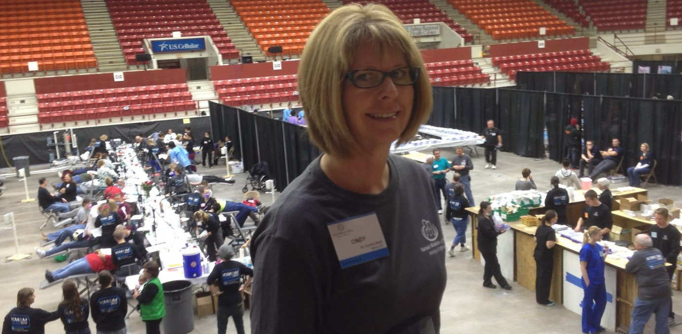 Salina orthodontist Cindy Reed stands above the clinic floor in Salina's BiCentennial Center