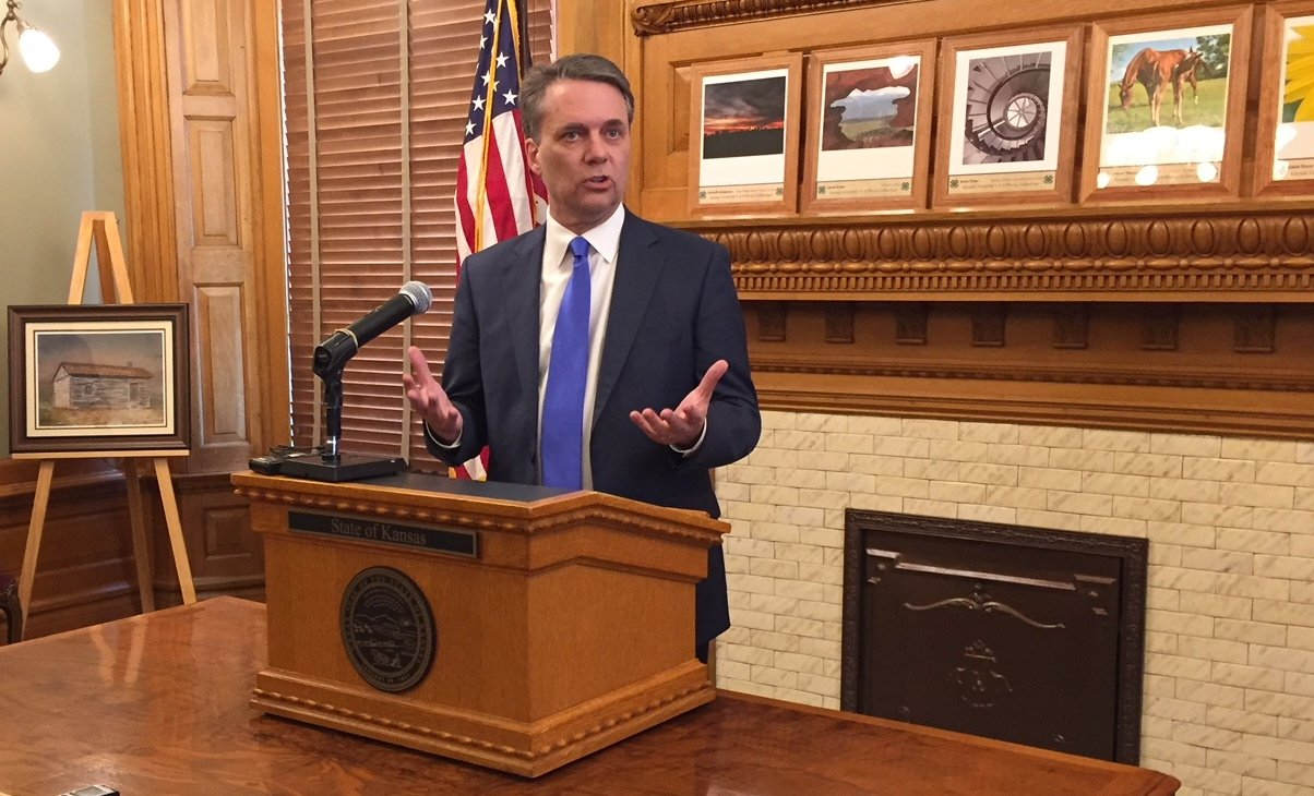 Governor Colyer speaking after signing the bills into law. (Photo by Stephen Koranda)