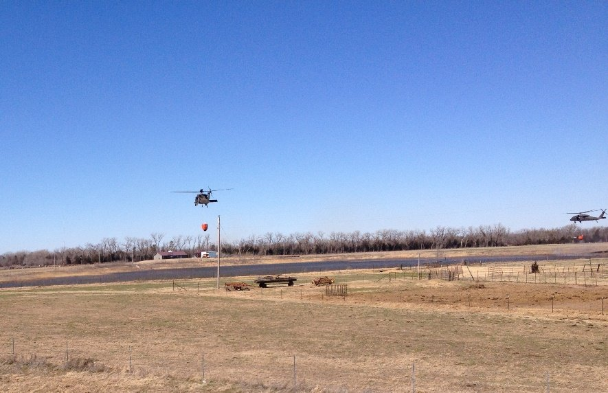 Blackhawk helicopters from the Kansas Army National Guard scoop water to help fight wildfires. (photo: Bryan Thompson)