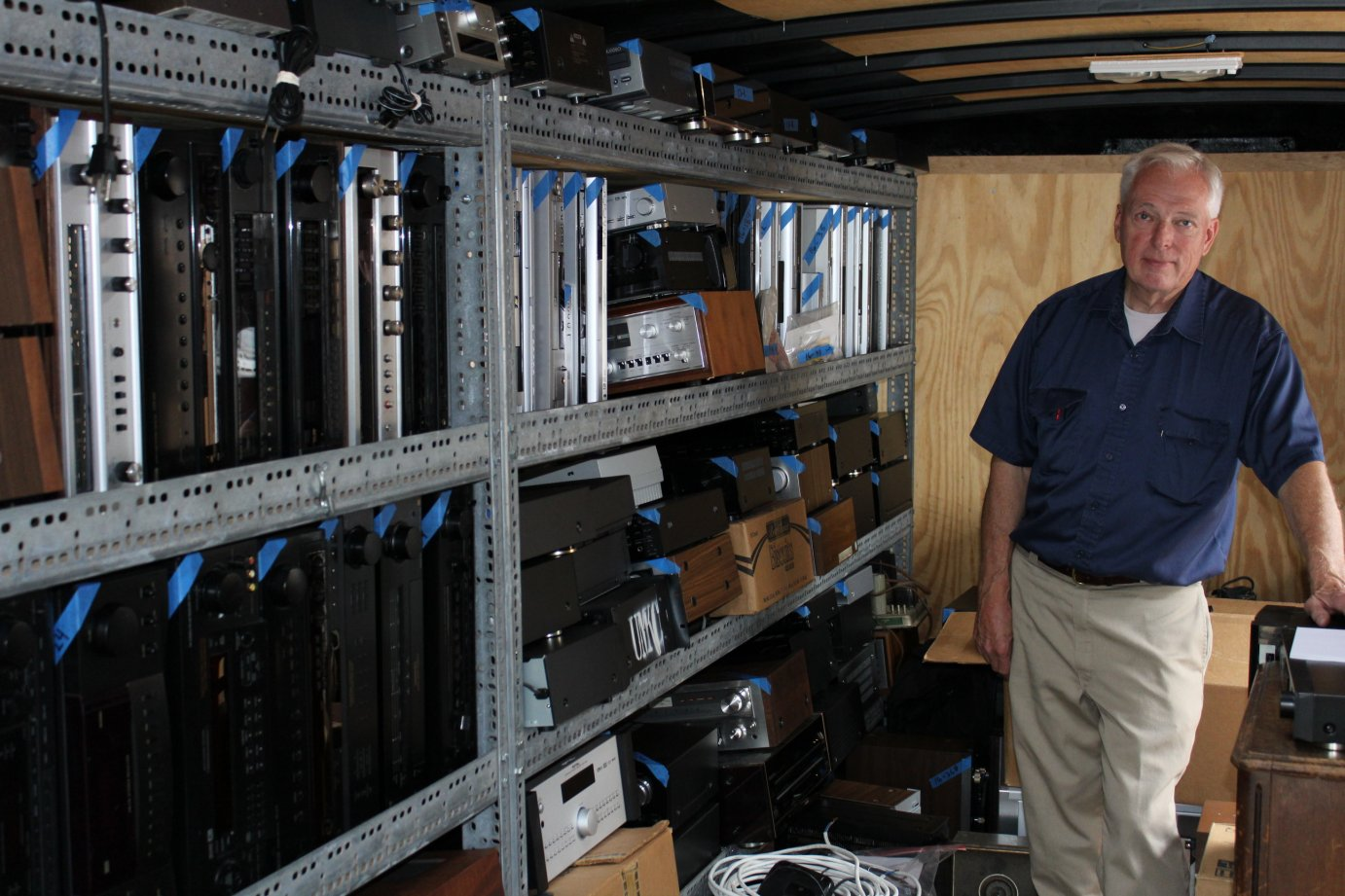Audio-Reader volunteer Dave Dunford, of De Soto, stands inside one of two trailers filled with donated audio equipment. Dunford inspects, repairs, cleans and restores all manner of audio equipment for the annual benefit sale For Your Ears Only. (Photo by J. Schafer)