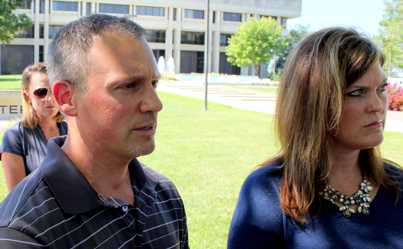 Vinny DiGiovanni and Amy Scott James speak to reporters outside the Kansas Judicial Center, which houses the Supreme Court. (Photo by Stephen Koranda)