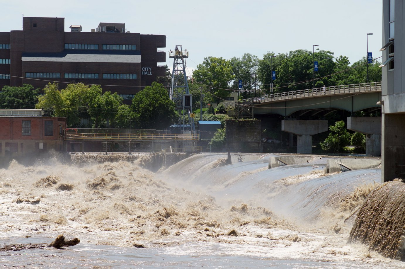 The muddy Kansas River surges past City Hall in Lawrence, KS on June 5th, 2015. Photo by Dan Mantyla.