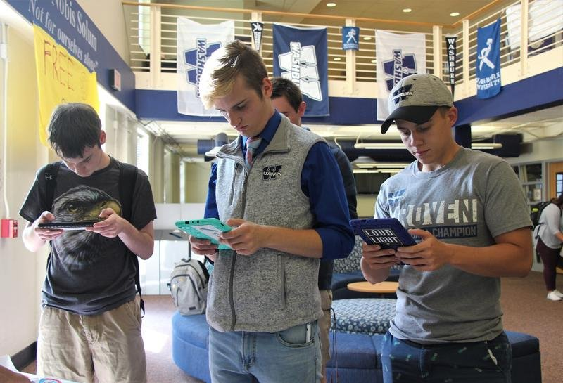 Students use electronic tablets to register to vote during a registration drive at Washburn University in September. (Photo by Celia Llopis-Jepsen /  Kansas News Service)