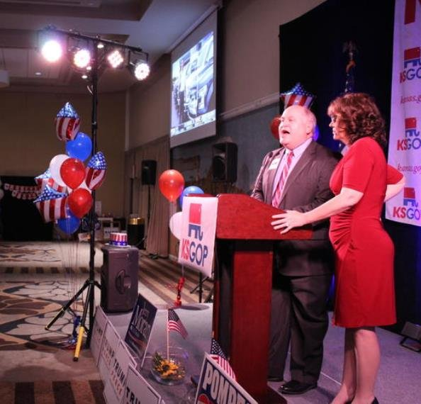 State treasurer Ron Estes, with his wife, Susan, speaks at the Sedgwick County GOP meeting on Election Night last year. (Photo:Nadya Faulx, KMUW)