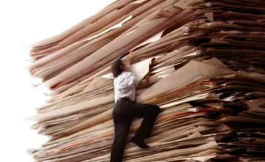 A sad, lost soul attempts to scale the mountain of files in KPR News Director J. Schafer's office*  (*note: not really. Image not shown actual size.) (Image credit: modernmom.com)