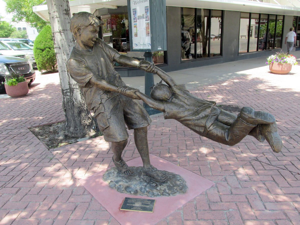 Statue Of Children Playing In Downtown Garden City, Kan. (Photo By David  Guth