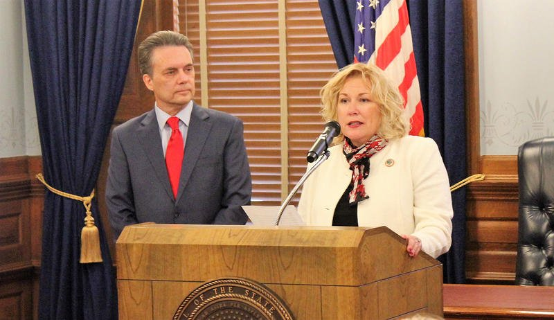 Gina Meier-Hummel, right, started her job as secretary of the Kansas Department for Children and Families on December 1. She was introduced by Lt. Governor Jeff Colyer, left.  (File photo / Kansas Public Radio)
