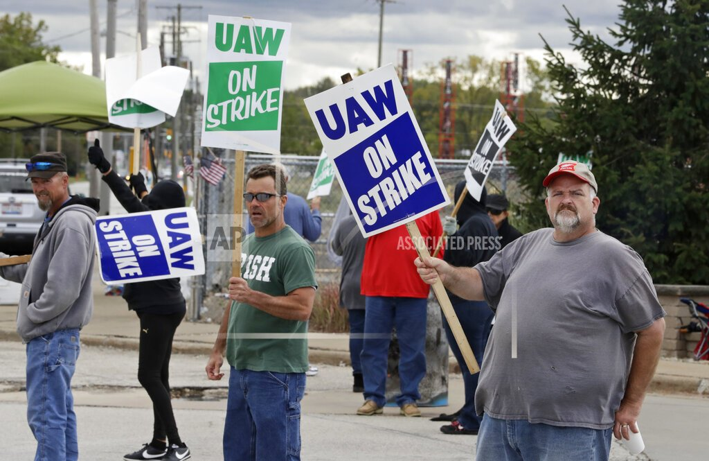 General Motors workers on strike in Parma, Ohio. (Photo by Tony Dejak / AP)