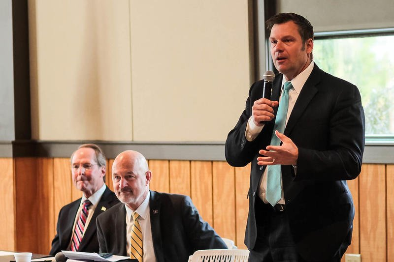 Kansas Secretary of State Kris Kobach with former state Senator Jim Barnett (left) and Insurance Commissioner Ken Selzer (center) at a Republican candidate forum.  (File photo from the Kansas News Service)