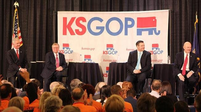 Republican candidates for governor Wink Hartman, Mark Hutton, Secretary of State Kris Kobach and Insurance Commissioner Ken Selzer on stage at the first debate Saturday. (Photo Credit: Nadya Faulx, KMUW)