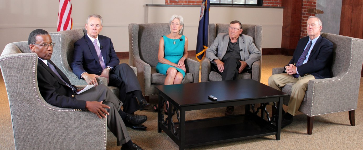 The four governors during the event in Topeka. From left to right are moderator Reggie Robinson, Republican Bill Graves, Democrat Kathleen Sebelius, Republican Mike Hayden and Democrat John Carlin. (Photo by Stephen Koranda)