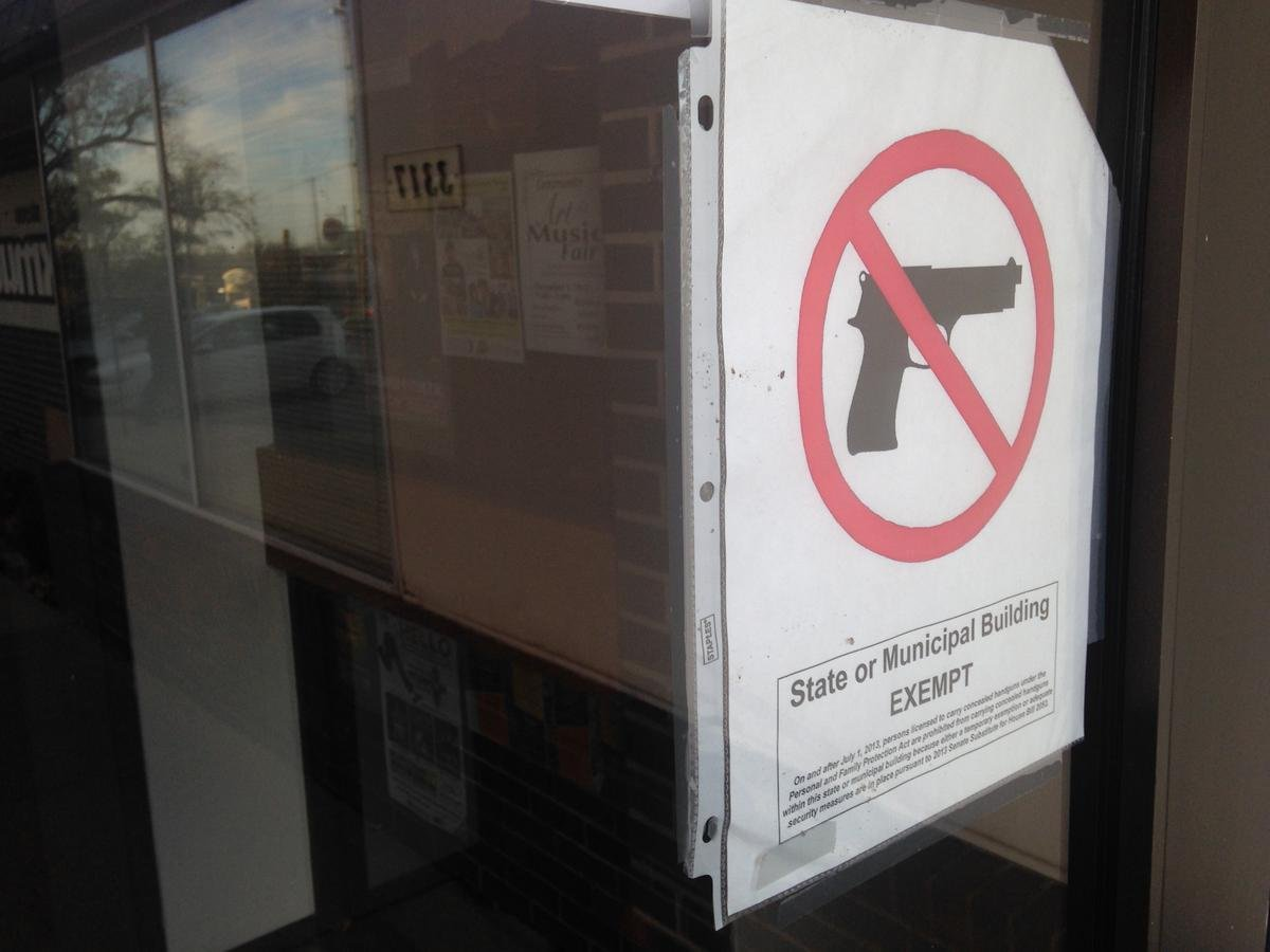 Gun control activists want lawmakers to ban assault weapons, strengthen background checks and impose other limitations on guns. (Photo Credit: Hugo Pham, KMUW Radio)