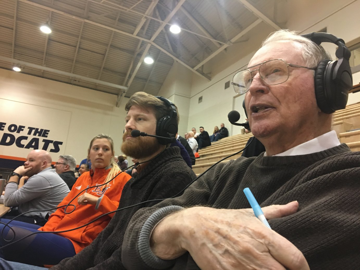 """Sports broadcaster Tom Hedrick, at right, has been the """"voice of the Baker Wildcats"""" since 1988. (Photo by Greg Echlin)"""