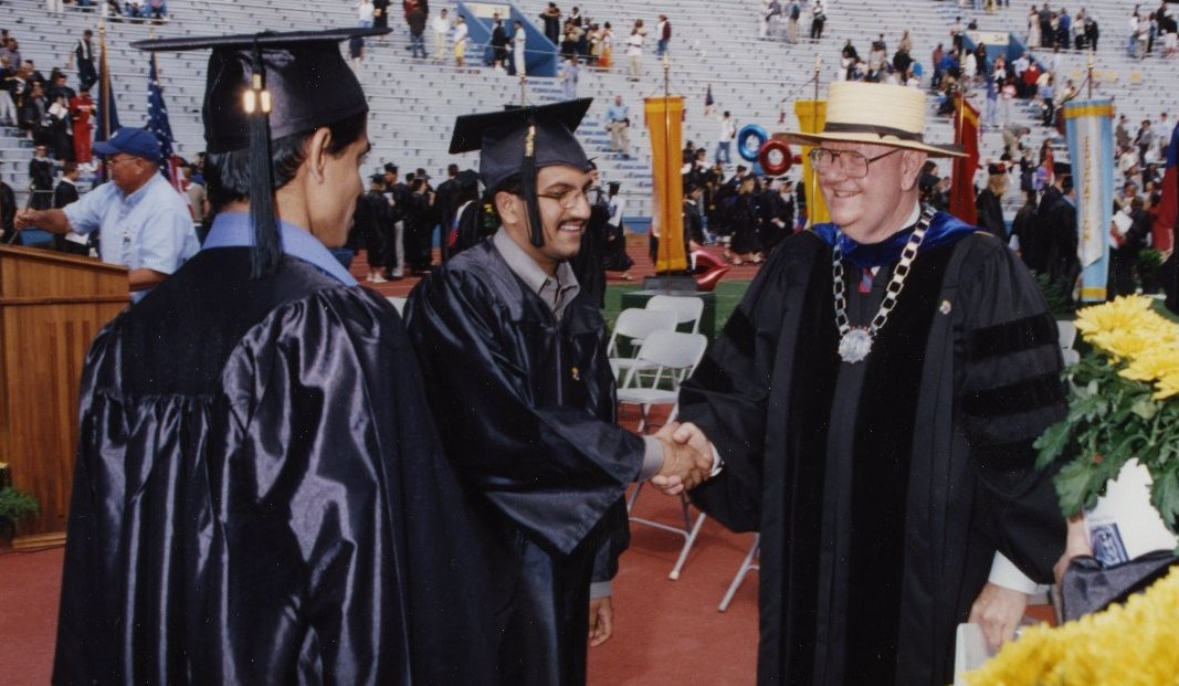Chancellor Hemenway meeting with students at graduation in 2002. (Photo from the University of Kansas Kenneth Spencer Research Library)