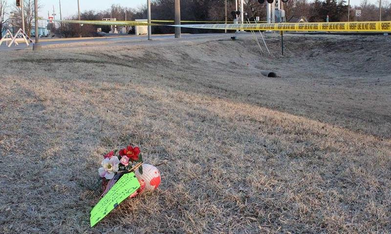 Flowers used as roadside memorial near the scene of a mass shooting in Hesston (Photo by Abigail Wilson)