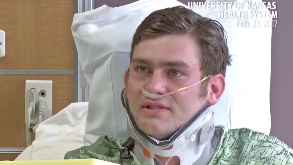Ian Grillot was shot while trying to stop a suspected gunman who had just shot two other men, one of them fatally, at Austins Bar and Grille in Olathe.  Grillot was shot in the arm and chest. (Screenshot from video / The University of Kansas Health System)