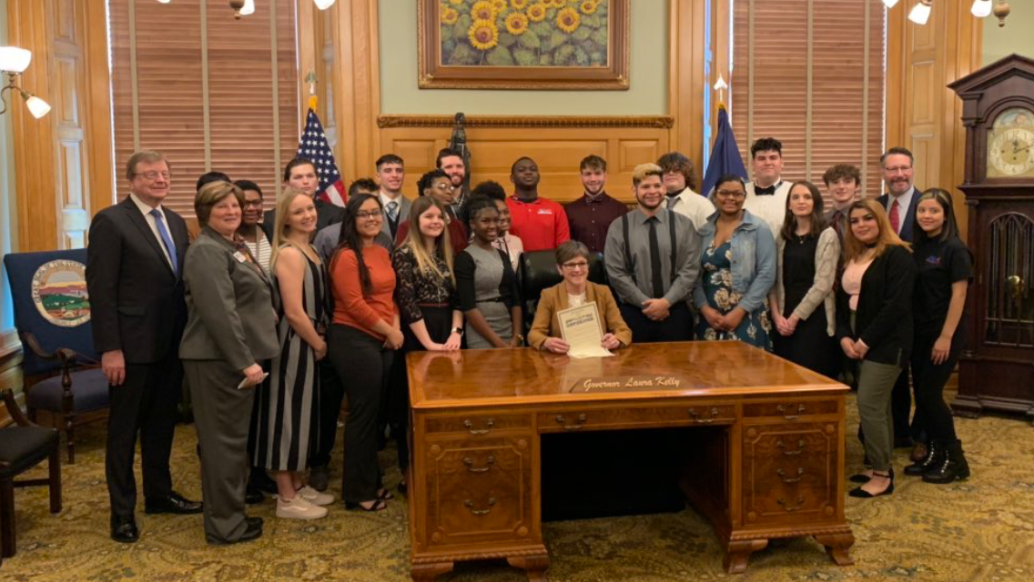 "JAG-K Day at the Kansas Statehouse, February 2020.  JAG-K students pose for a photo with Kansas Governor Laura Kelly, a supporter of JAG-K.  JAG or, ""Jobs for America's Graduates,"" is a national program designed to help students suceed in life.  The Kansas Chapter is called JAG-K. (Photo from JAG-K)"