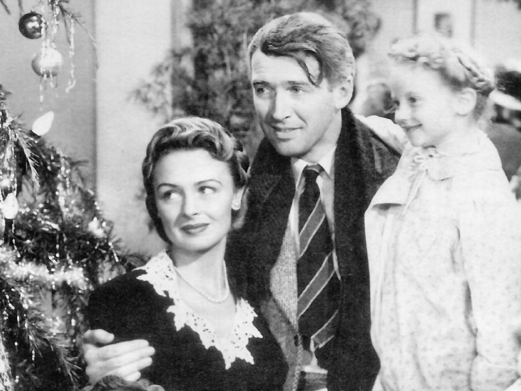 """An image of George Bailey (played by Jimmy Stewart) and family in Frank Capra's holiday classic, """"It's a Wonderful Life."""""""