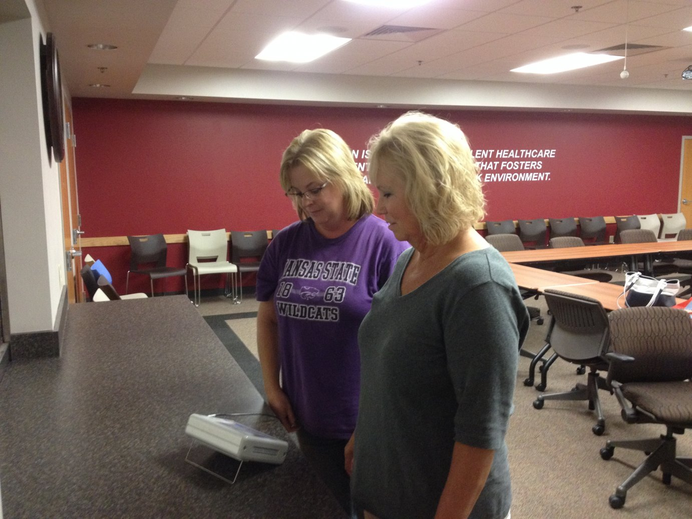 Salina resident Janis Wearing weighs in with Shari Sutton at Salina Family Health Care. (Photo by Bryan Thompson)