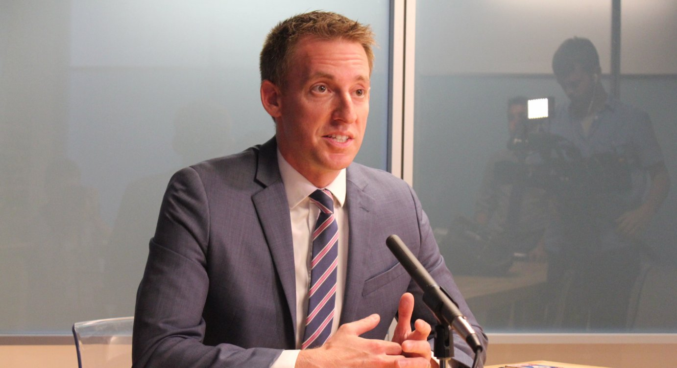 Jason Kander speaking at a recent stop in Lawrence. (Photo by Stephen Koranda)