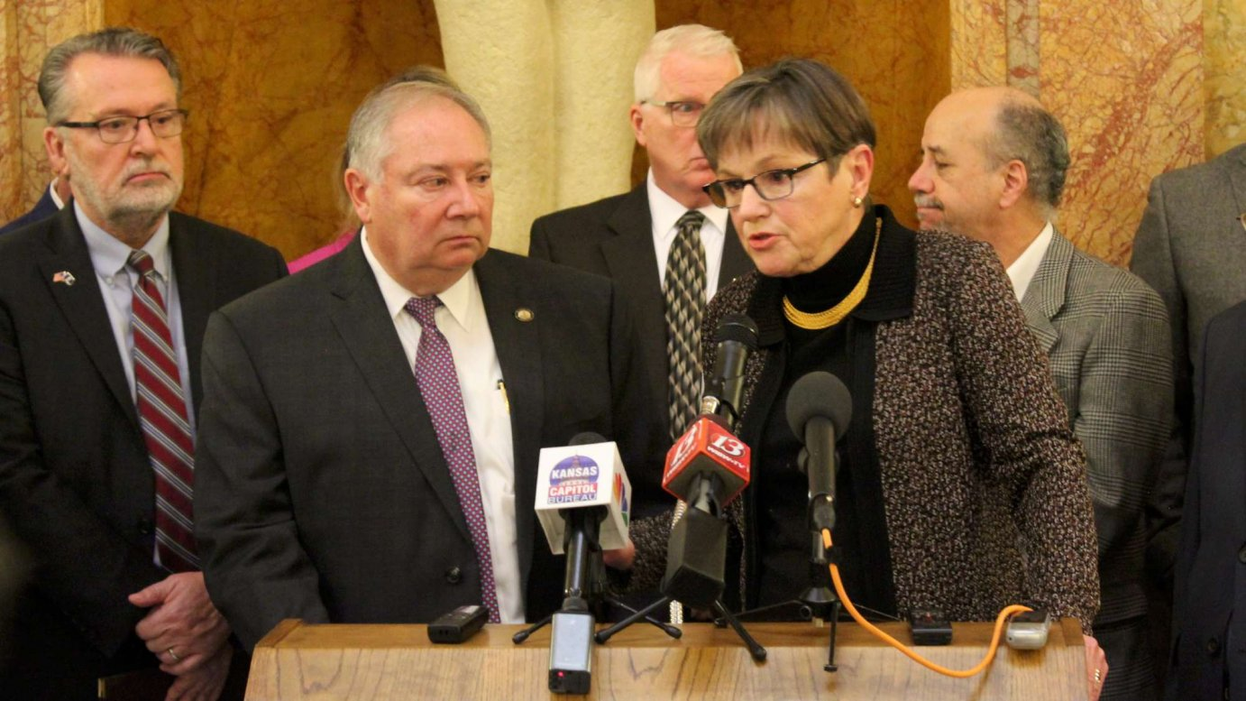 Gov. Laura Kelly and Sen. Jim Denning unveil their Medicaid agreement at the Statehouse. (Photo by Stephen Koranda)