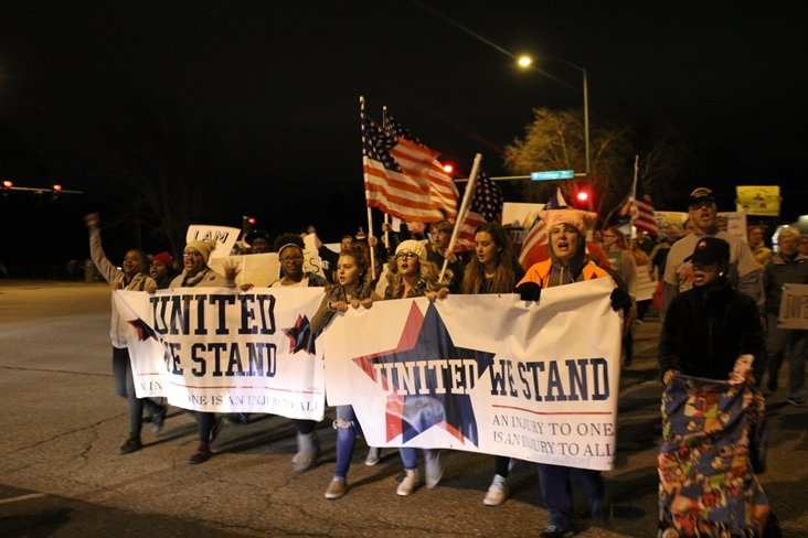 The fundraising dinner for Kobach supporters attracted crowds of anti-Kobach and anti-Trump demonstrators and a smaller group of counter-protesters. (Photo by Jim McLean / Kansas News Service)