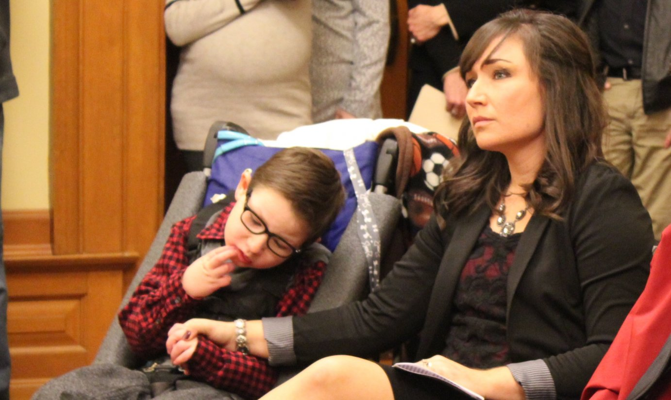 Kiley Klug and her son Owen at the hearing. (Photo by Stephen Koranda)
