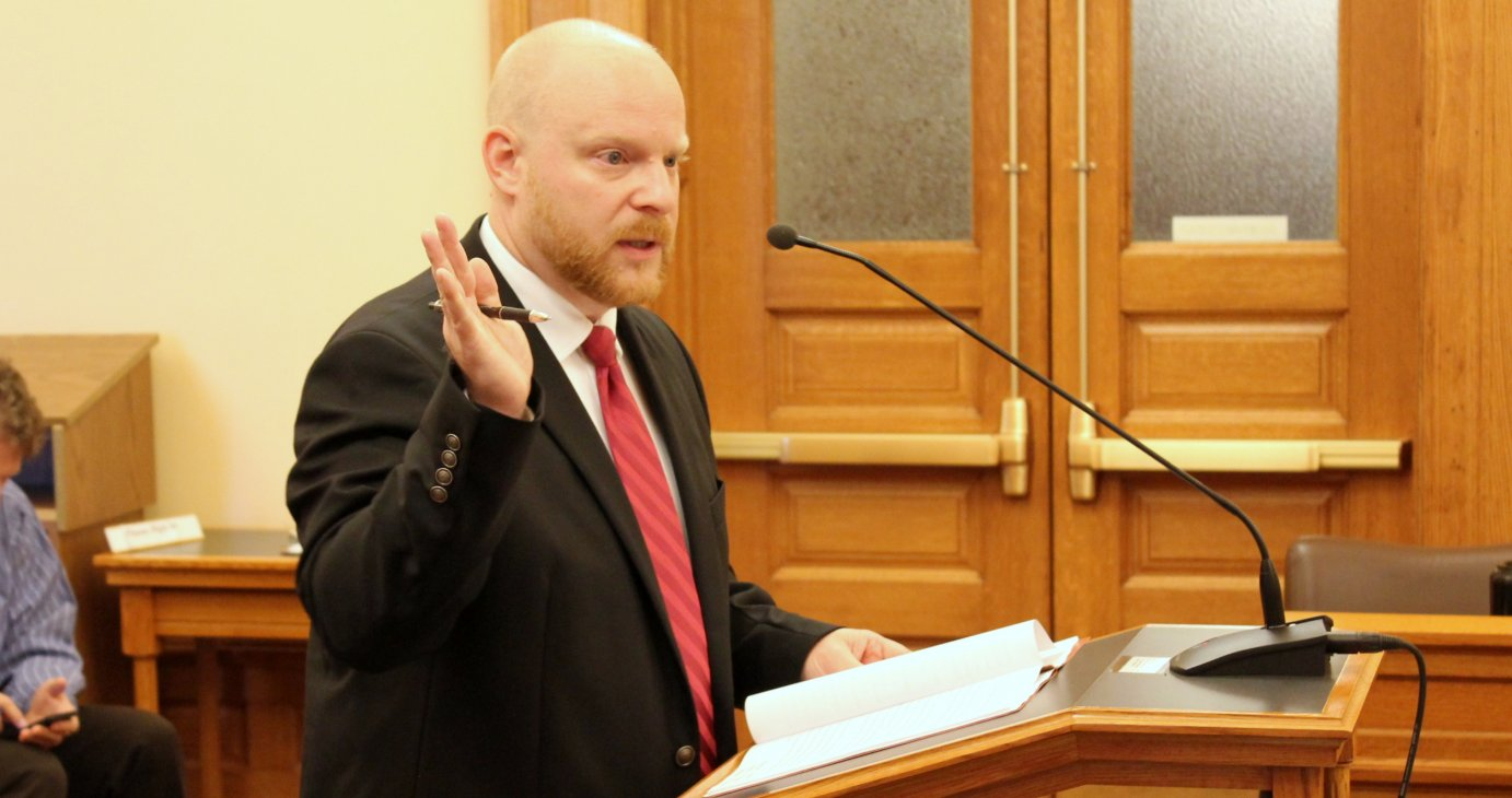 Kraig Knowlton, with the Department of Administration, explaining the proposed changes to a committee. (Photo by Stephen Koranda)