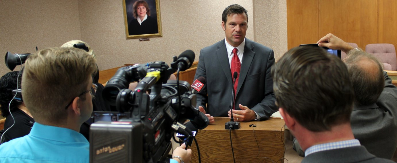 Kobach speaking to reporters earlier this year. (Photo by Stephen Koranda)