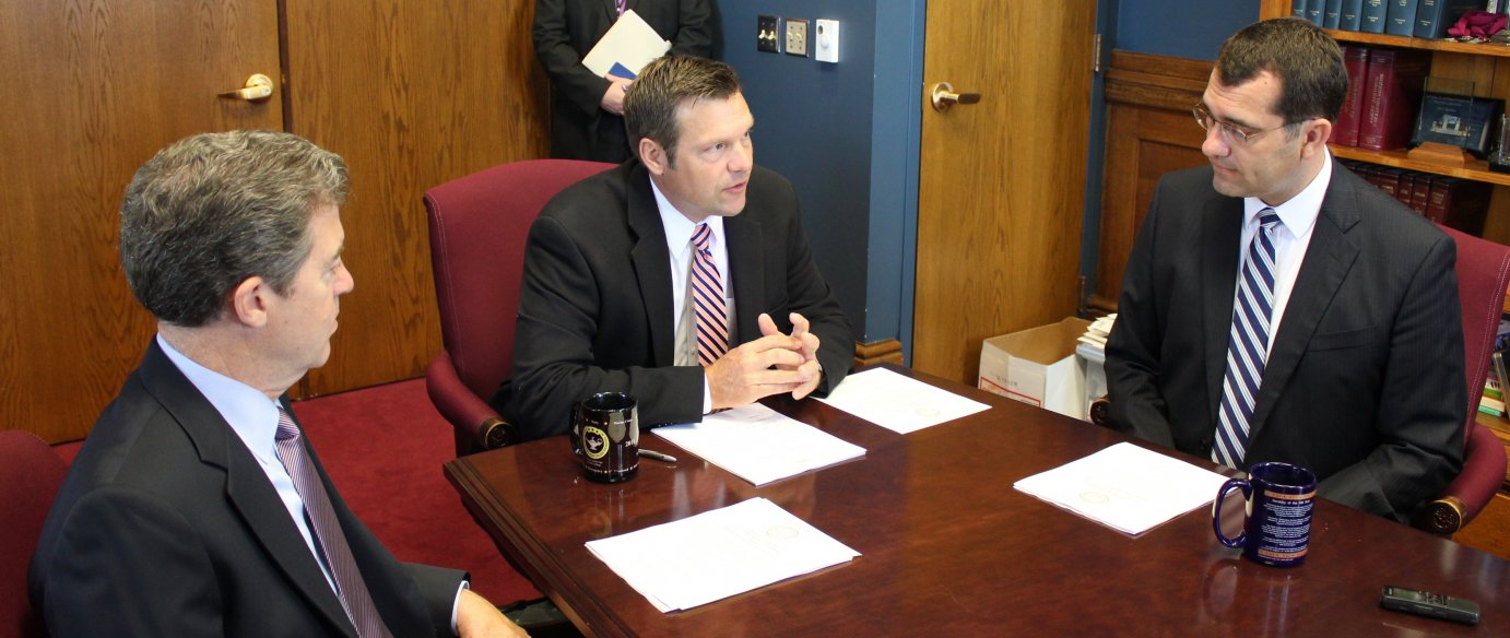 Secretary Kobach (center) chairs the State Board of Canvassers. He's flanked by Governor Sam Brownback (left) and Attorney General Derek Schmidt. (Photo by Stephen Koranda)