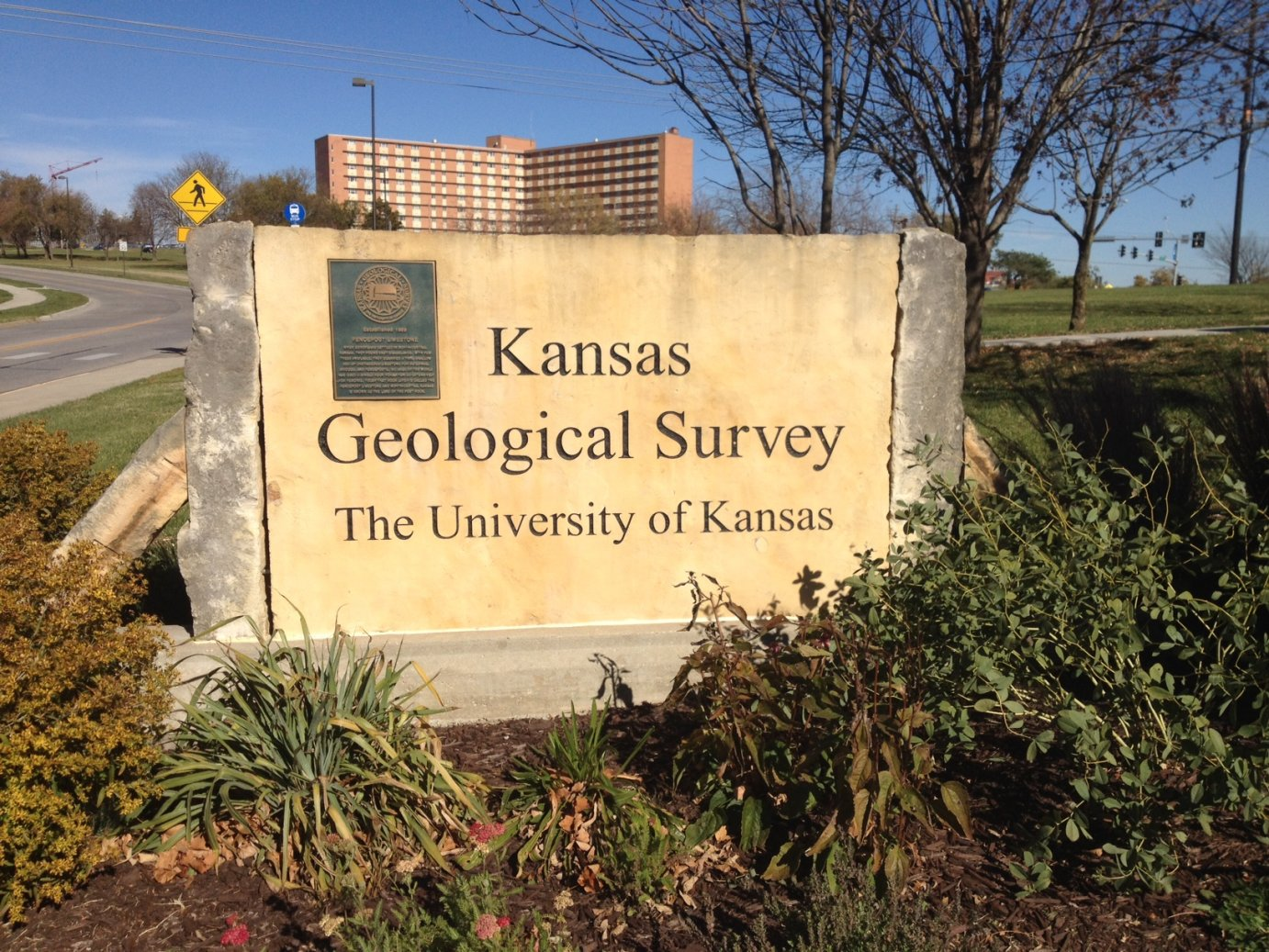 Entrance sign to the Kansas Geological Survey at the University of Kansas.  The survey has installed new monitors in south-central Kansas to record increased seismic activity. (Photo by J. Schafer)