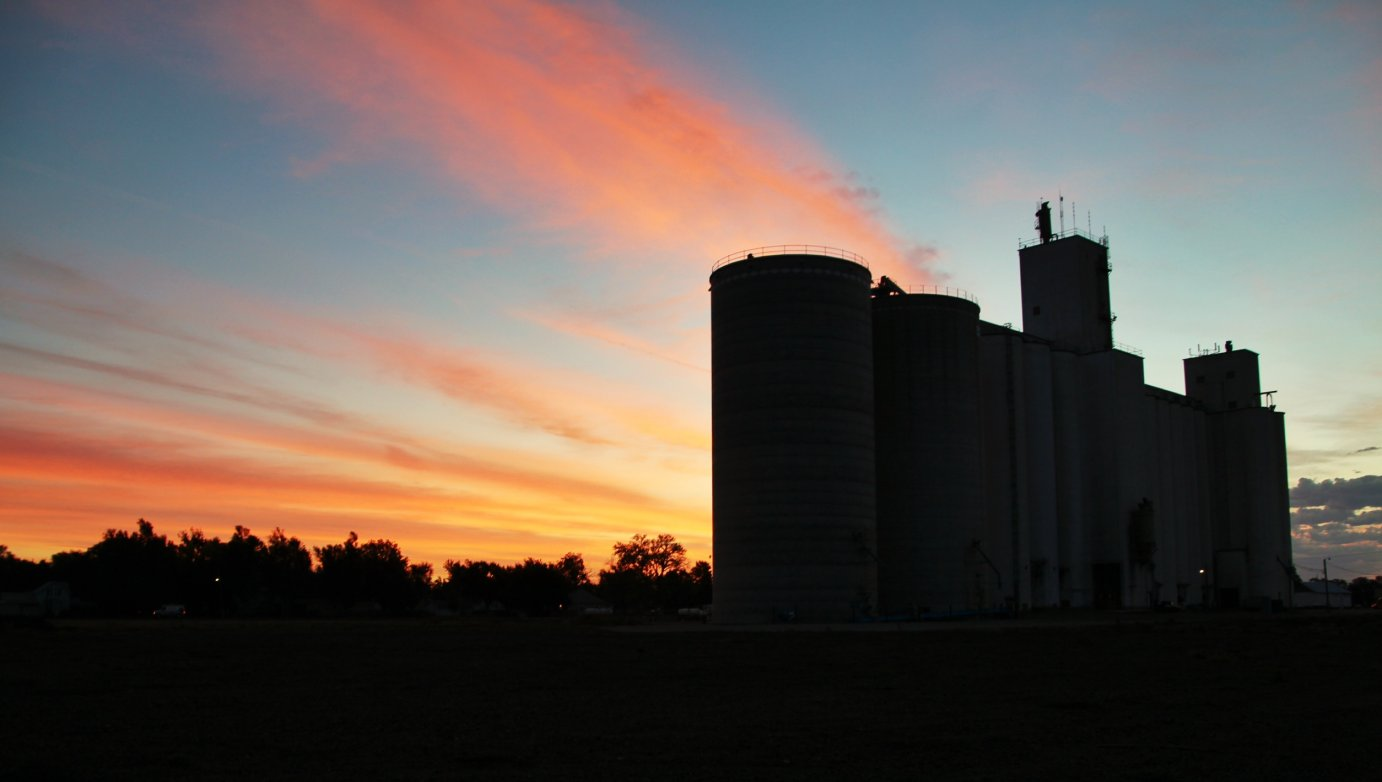 The sun rises behind a typical Midwestern grain elevator; this one is in Nickerson, Kansas. (Photo by J. Schafer)