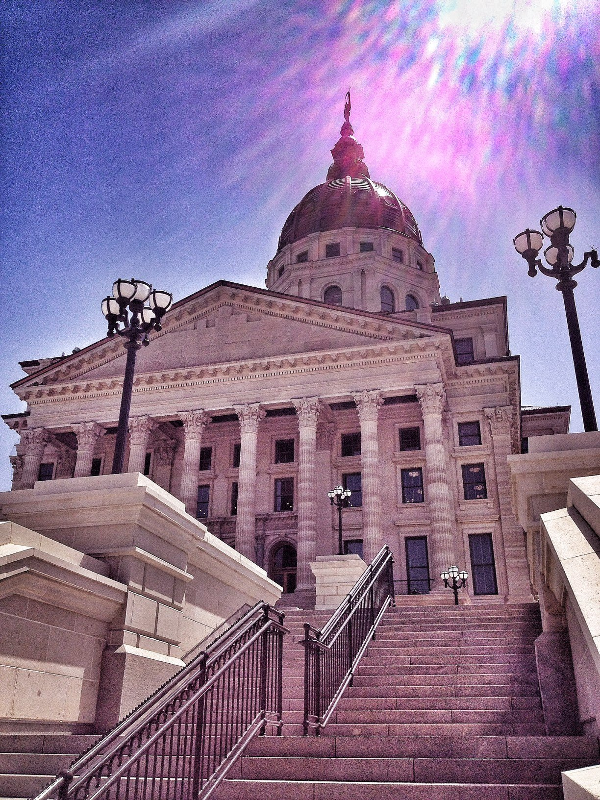 Sunlight shines down on the shiny, new copper dome at the Kansas Statehouse. (Photo by J. Schafer)