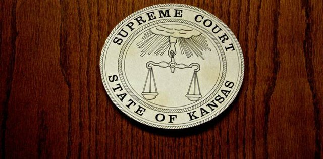 Seal of the Kansas Supreme Court, the highest court in the state.