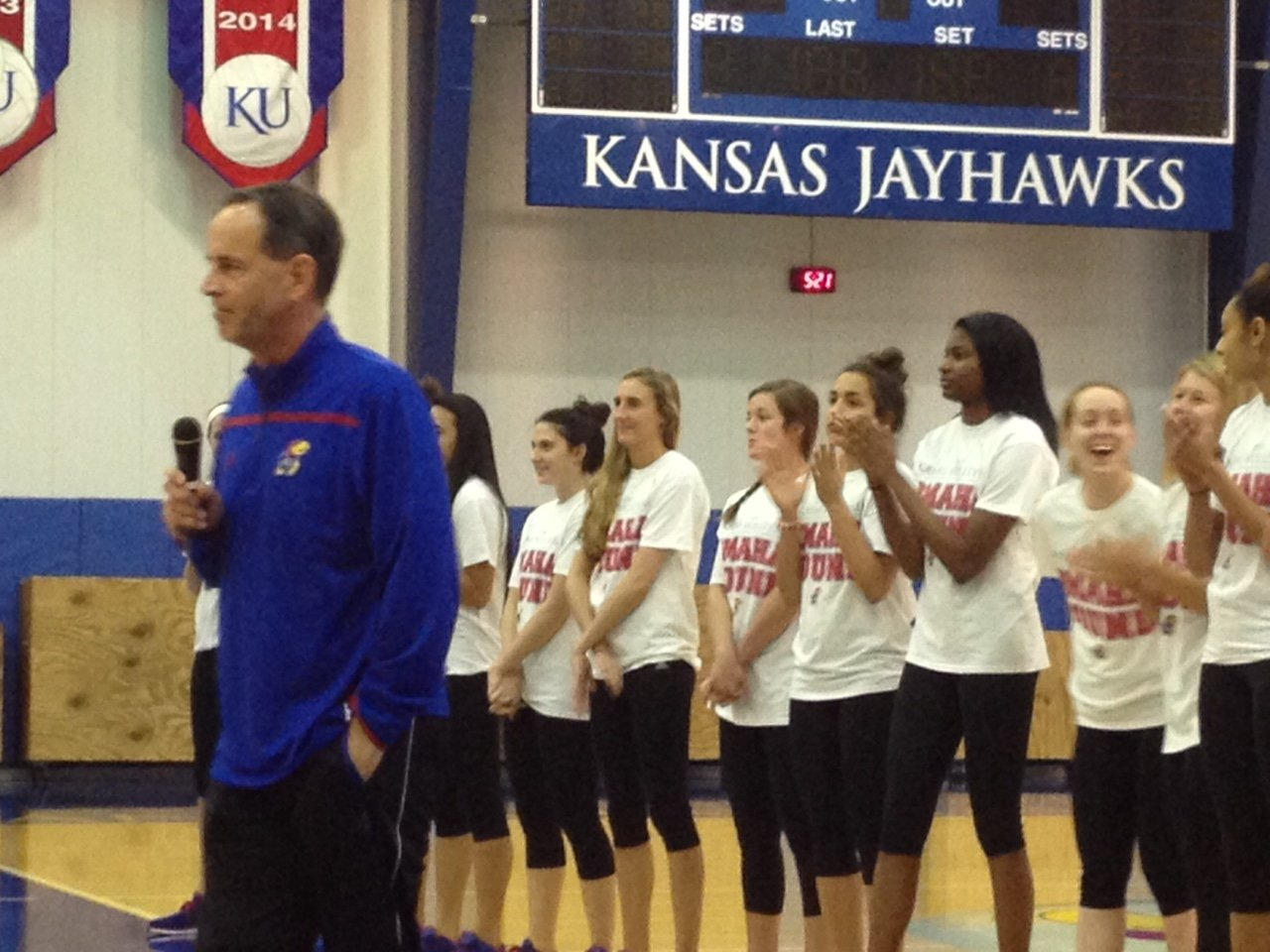 KU Volleyball Coach Ray Bechard and his players address fans during a welcome home celebration Sunday night.  The volleyball team has advanced to the first NCAA Final Four in school history.  KU plays Nebraska Thursday in Omaha in the national semi-finals.  (Blurry photo by J. Schafer)
