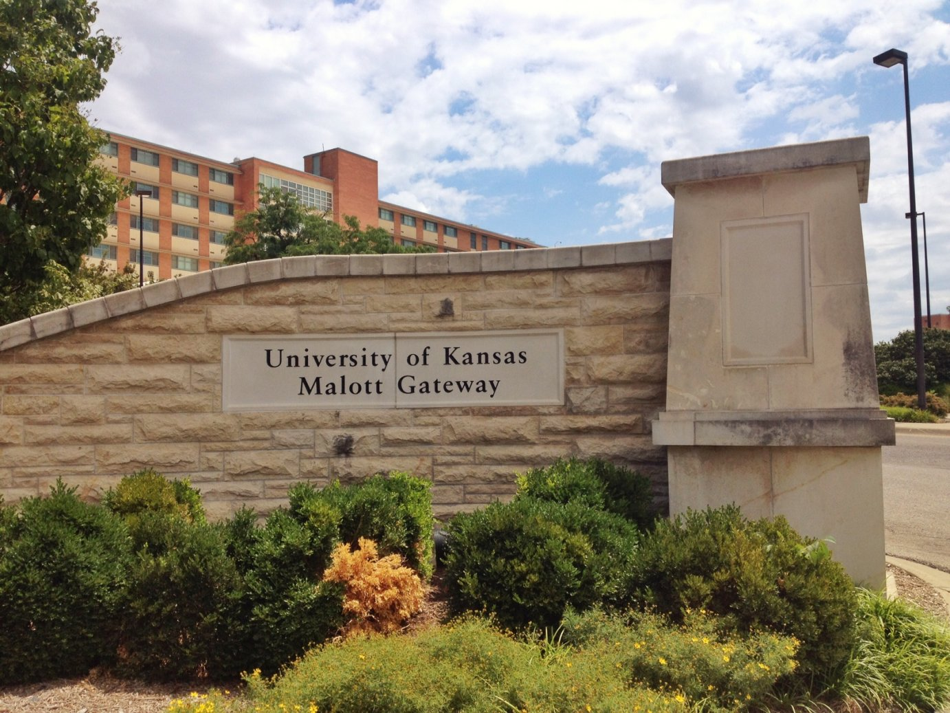 "This gate welcomes visitors entering the KU campus from the west.  KU, Haskell and Ottawa universities are trying to improve student retention by reaching out earlier to ""at-risk"" college students.  (Photo by J. Schafer)"