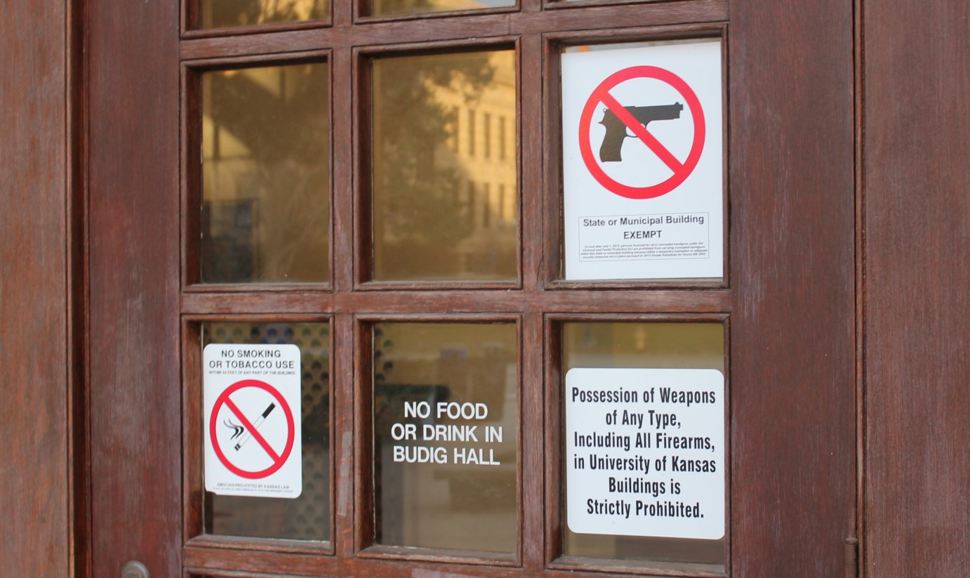 Signs barring guns in a building on the KU campus. (Photo by Stephen Koranda)
