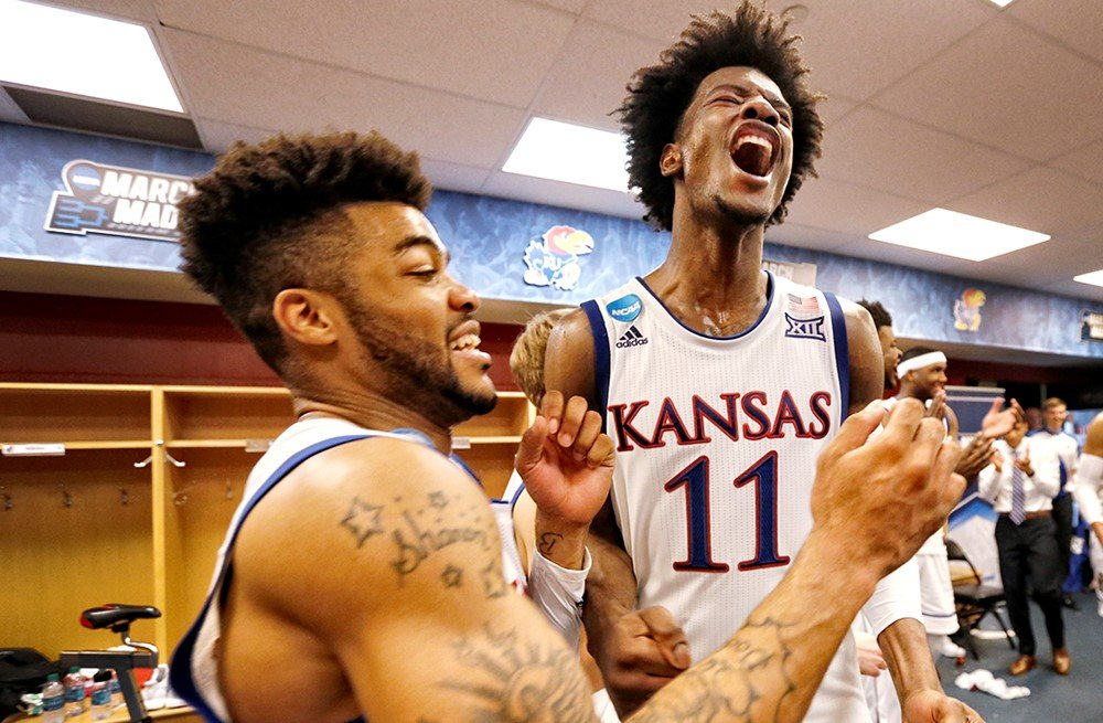 KU teammates Frank Mason III and Josh Jackson celebrate their victory over Michigan State to advance to the Sweet 16 of the NCAA Men's Basketball Tournament. (Photo from KU Athletics)