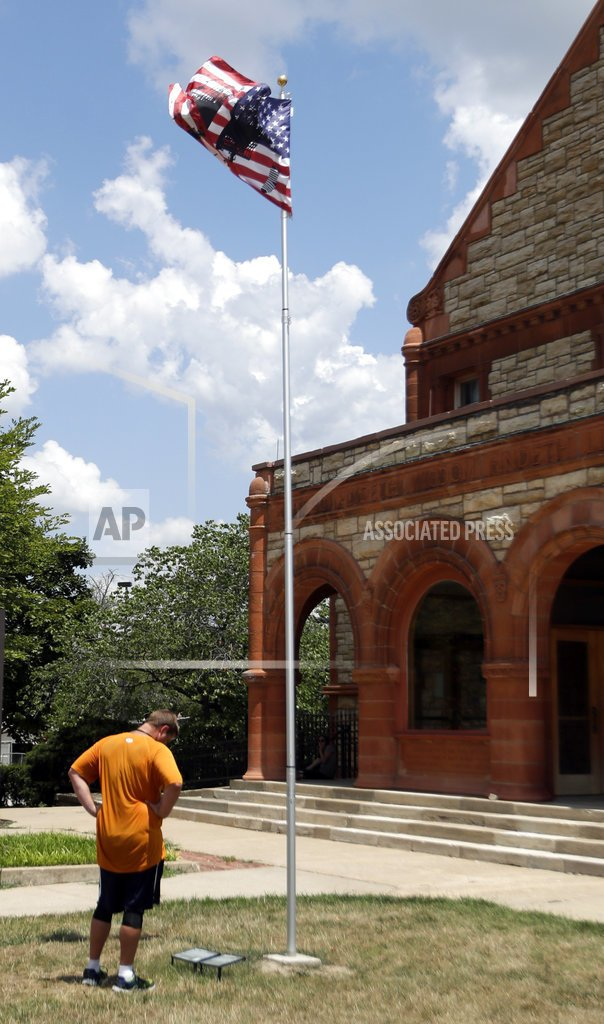 An art piece called Untitled (Flag 2), flies on the University of Kansas campus in Lawrence, Kan., Wednesday, July 11, 2018. It is part of a series of flag pieces that have flown on the Lawrence campus in the last several months as part of a national art project. (AP Photo/Orlin Wagner)