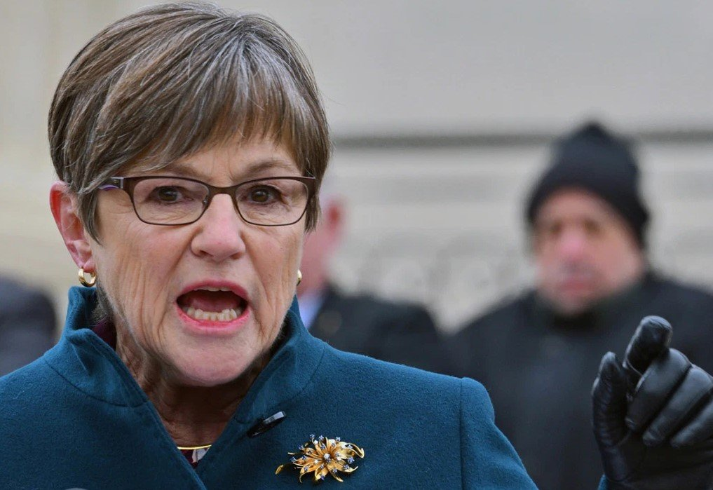 Kansas Governor Laura Kelly says she will ease stay-at-home orders using evidence-based data, but COVID-19 data used by the state omits many cases. (Photo from Mark Reinstein/Corbis via Getty Images and Kaiser Health News)