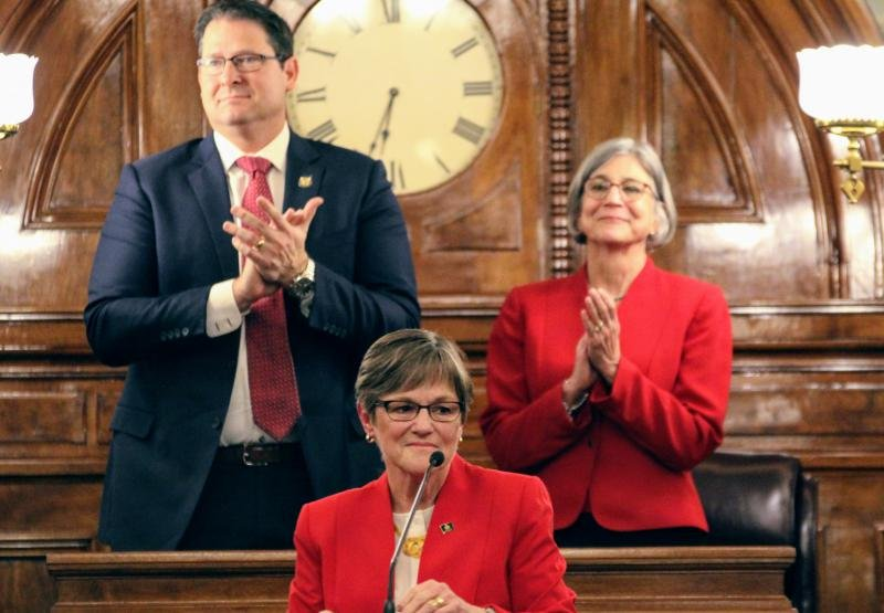 Democratic Governor Laura Kelly delivers her first State of the State speech on Wednesday night, flanked by Republicans House Speaker Ron Ryckman and Senate President Susan Wagle.  (Photo by Jim McLean / Kansas News Service)