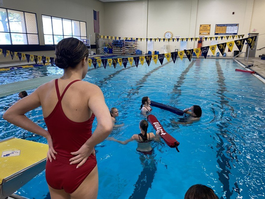 Prospective lifeguards practice deep-water saves during a certification class at Wichita Northwest High School. (Photo by Suzanne Perez, Kansas News Service)
