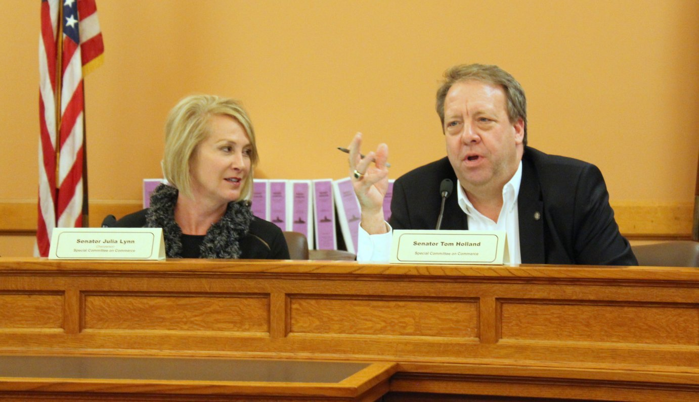 Republican Senator Julia Lynn (left) and Democratic Senator Tom Holland at a meeting last year. (Photo by Stephen Koranda)