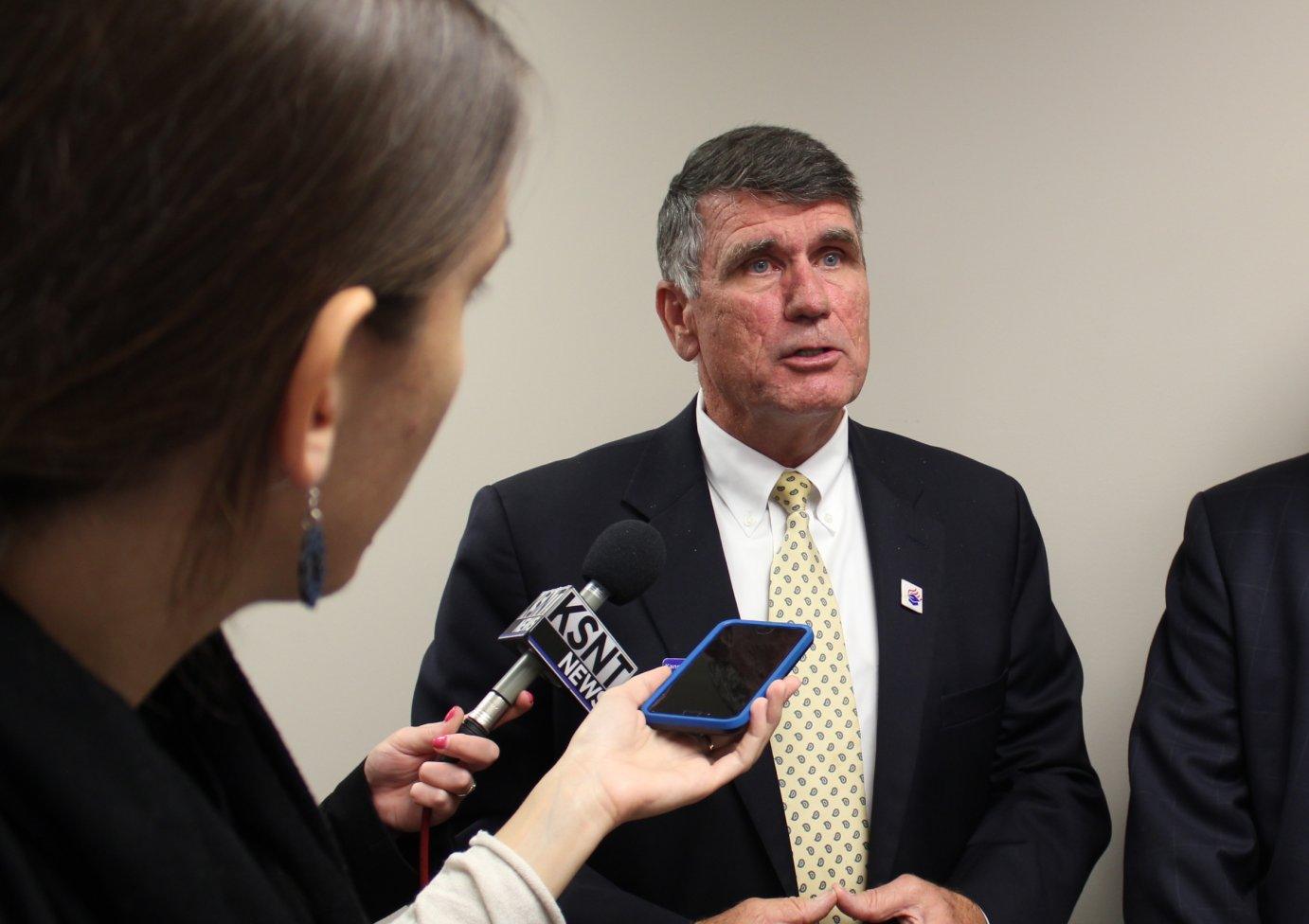 Board of Education Chairman Jim McNiece speaking to reporters. (Photo by Stephen Koranda)