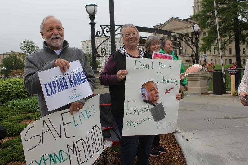 Demonstrators greeted lawmakers at the Capitol in Topeka this week. On Wednesday, a proposal for expanding Medicaid lacked the votes needed to force an up-or-down roll call vote in the Kansas Senate.  (Photo by Jim McLean / Kansas News Service)